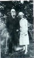 thumbnail of 19320000-virgil_jones_and_daughter_mollie_alta_jones_grothe-on_grothe_farm_6mi_east_chillicothe_mo.jpg